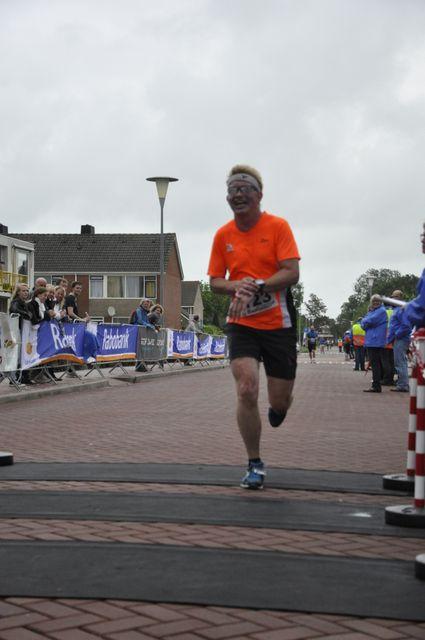 Over de finish. Klokje indrukken. Foto: Martin de Jonge